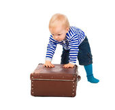 Little child  with a suitcase  isolated on a white background — Stock Photo