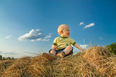 Child smiling against the blue sky — Stok fotoğraf