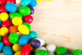 Frame  a background from colorful sweets of sugar candies — Stock Photo