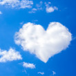 Blue sky with a white cloud in the form of heart — Photo