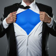 Businessman acting like a super hero - Stock Photo