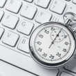 Stopwatch on a laptop keyboard — Stock Photo
