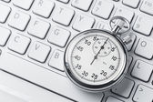Stopwatch on a laptop keyboard — Stock Photo