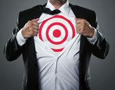 Businessman showing target symbol — Stock Photo