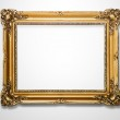 Grunge gold wooden frame on the white wall — Stock Photo #6758284