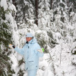 Girl snow fir spruce — Stock Photo