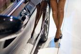 Feet girl near the car — Stock Photo