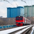 A local train on snow covered tracks in Moscow — Stockfoto