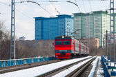 A local train on snow covered tracks in Moscow — Stock Photo