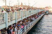 Fishermen and tourists are on the Galata Bridge in Istanbul — Stock Photo