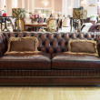 Classic leather sofa in a furniture store — Stock Photo