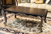 Classic table in a furniture store — Stock Photo