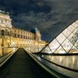 The Louvre museum at night in Paris — Photo