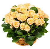 Natural beautiful roses in a basket — Stock Photo