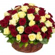 Natural red and yellow roses in a basket — Stock Photo