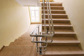 Staircase with metallic handrails — Stock Photo