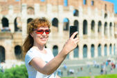 Selfie of a young female tourist on the background of the Coloss — Stock Photo