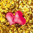 Hearts on gold backgraund — Stock Photo