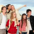 Group happy surprised teens — Stock fotografie