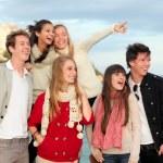 Group happy surprised teens — Stock Photo