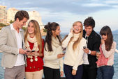 Teens with mobile or cell phones — Photo