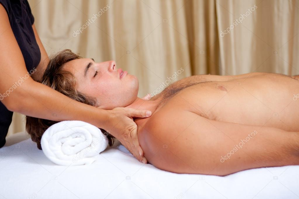 Man getting relaxing massage at spa  Stock Photo #12490683