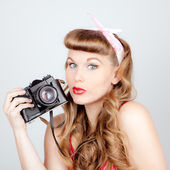 Retro woman with camera — Stock Photo