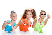 Happy kids with thumbs up to eating — Stock Photo