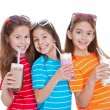 Children drinking milk drinks — Stock Photo