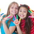 Happy kids playing paint — Stock Photo