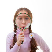 Child magnifying glass — Stock Photo