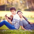 Summer romance with guitar - Stock Photo