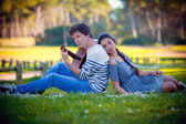 Romantic couple playing guitar — Stock Photo