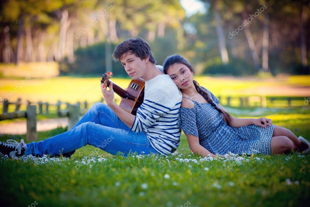 Romantic couple in love playing guitar — Stock Photo #20803289