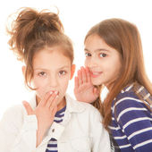Children whispering secrets — Stock Photo