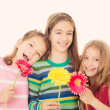 Happy children with flowers — Stock fotografie