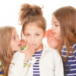 Kids whispering bad news - Foto Stock