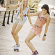 Stock Photo: Summer fun healthy girls with skateboards.