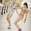 Summer fun healthy girls with skateboards. — Stock Photo #40853791