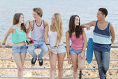 Group of diverse teens at beach — Stock Photo