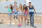 Mixed race confident teens on student vacation — Stock Photo