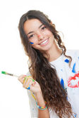Teen girl painting messily — Stock Photo