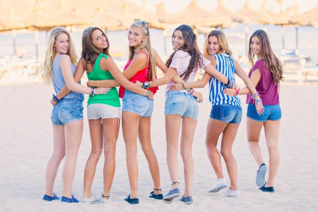 group of teens at beach on summer vacation.