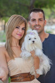 People with pet Maltese dog — Stock Photo