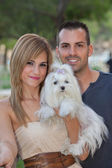 Young couple with pet maltese dog — Photo
