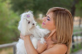 Woman with family pet Maltese dog — Stock Photo