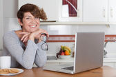 Woman working or studying at home — Stock Photo