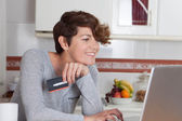 Woman shopping online with credit card — Stock Photo
