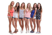 Group of healthy tanned smiling summer teenagers — Stock Photo