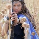 Постер, плакат: Fairytale girl with bow and arrow